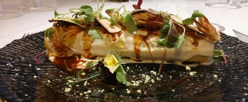 Cannelloni of Spanish bull tail with black truffles and artichoke chips